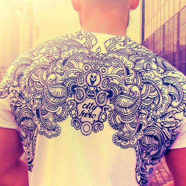 "Создавая наши дизайны, мы всегда думаем о взглядах, которые будут тянуться за вами вслед. Creating our designs, we're thinking of looks which'd follow you T-shirt ""Ganesha's garden B/W"" 2,199 руб | 39,59 eur #paisley #skull #graphictee #teeforhim #cityhero"
