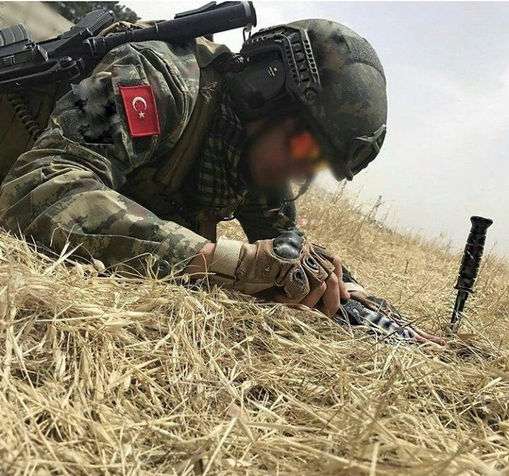 Turkish soldier defusing an improvised explosive device left by ISIS