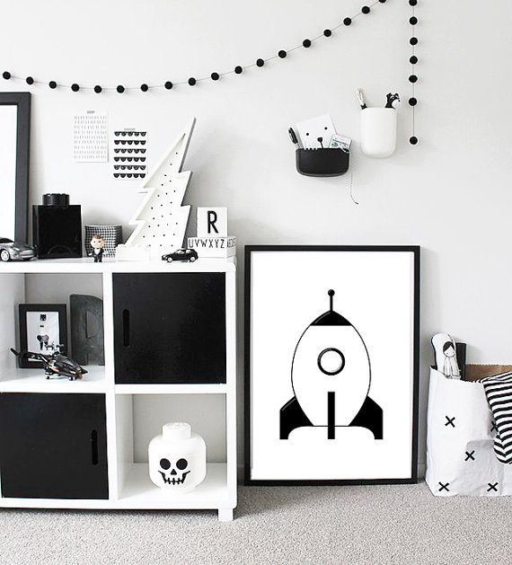 I just love the black and white theme for a kids room. It's clean but very cool. A large poster will give the room some serenity.