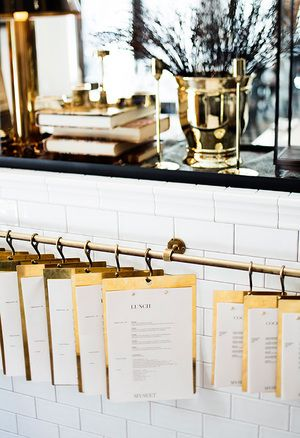 Hanging Menu, Its a nice classy design. I really like how they hang for storage! The menus hanging also create a cool decoration!