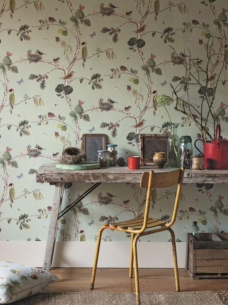 Inspired by an 18th Century painting of plants and animals, this elegant wallpaper design features various British birds on trailing foliage