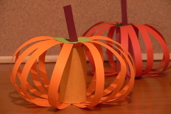 Pumpkins made from construction paper and a cardboard tube.