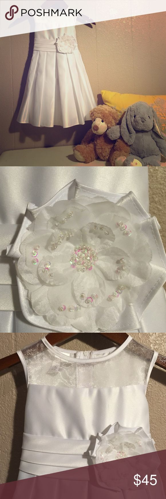 NWT Julia Lee girls dress White satin little girls dress with sheer organza neckline. Has a pleated waistband and soft pleated skirt with back tie sash. Floral accent pin with just the right amount of sequins. Unaltered Julia Lee Dresses Formal