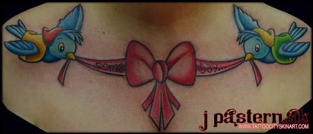 Disney Tattoo on back with lace down