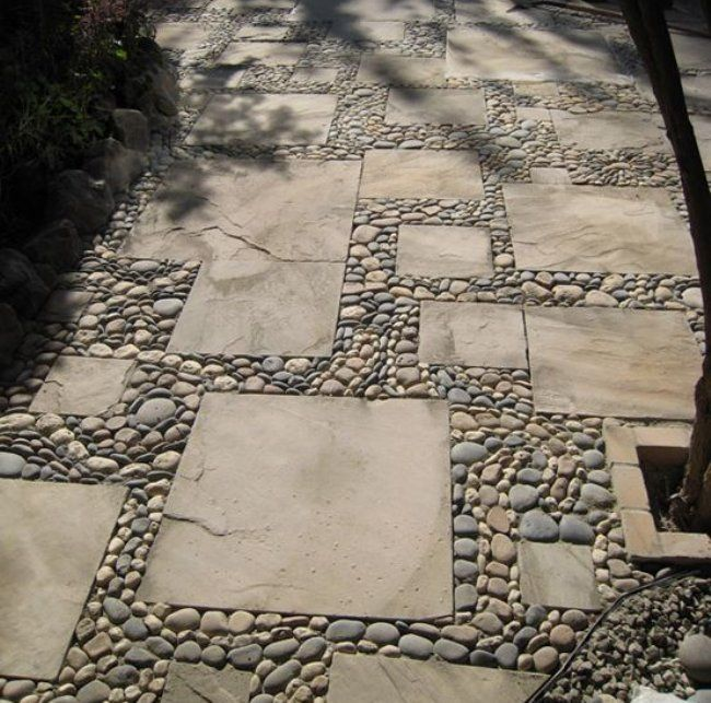 stone walkway made from combination of cut stone slabs and pebbles