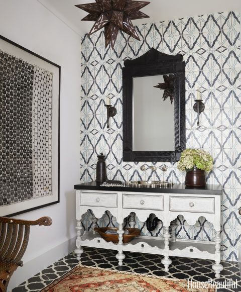 A powder room in a worldly Los Angeles home features Ann Sacks's Maghreb 4 tiles on the wall. Click through for more designer bathrooms and the best bathroom decor.