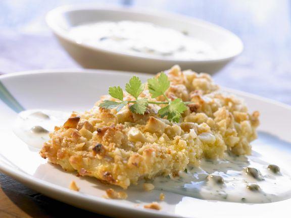 Fisch mit Macadamia-Haube und Kapernsoße ist ein Rezept mit frischen Zutaten aus der Kategorie Meerwasserfisch. Probieren Sie dieses und weitere Rezepte von EAT SMARTER!