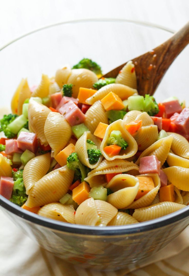 Garden Party Pasta Salad: Packed with crunchy veggies, ham, cheddar cheese and tossed with zesty Italian dressing, this pasta salad is sure to be a hit at your next picnic or barbecue.