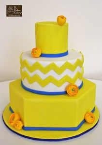 yellow ranuculus chevron cake