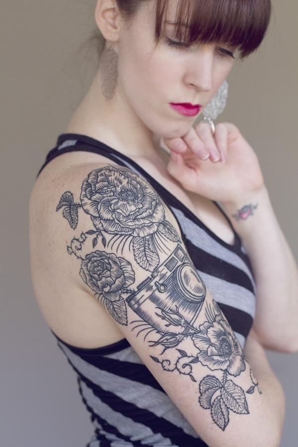 Floral engraving + vintage camera tattoo