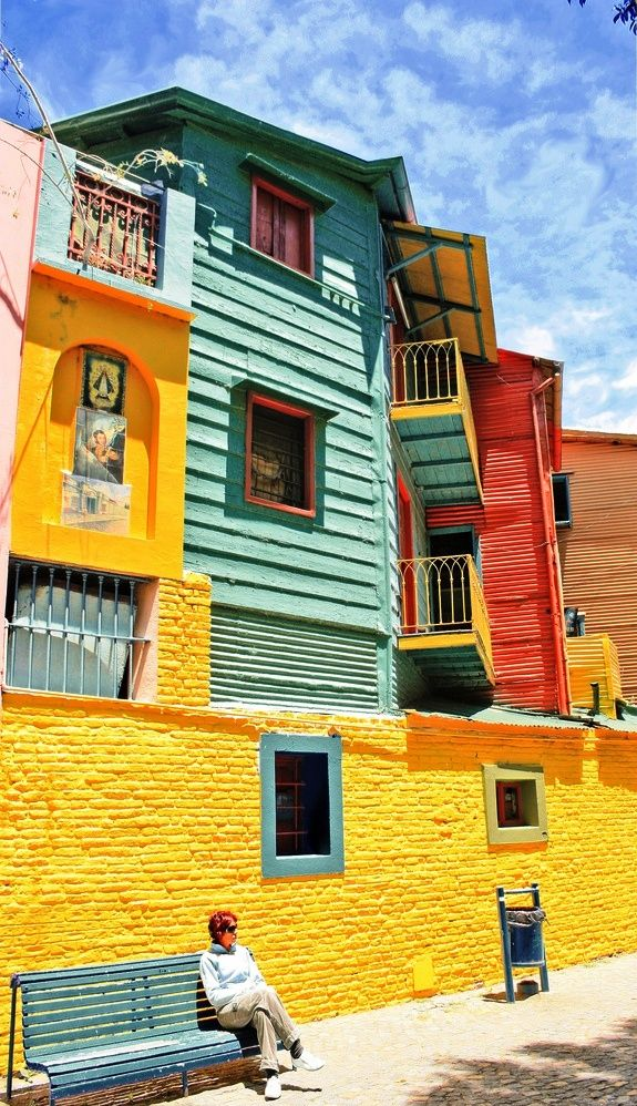 Located in the southeastern portion of Buenos Aires is La Boca. known for its open air museum. A traveler walking down the pedestrian street of Caminito will notice exceptional murals and graffiti by local artists. In the working class enclave at the mouth of the Riachuelo River--a neighborhood constructed with scrap materials and leftover paints--the houses are painted bright cheerful colors,which make the neighborhood a draw to residents and visitors alike.