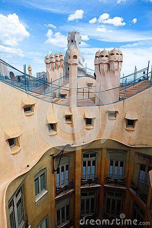 BARCELONA, SPAIN – APR 14: Chimneys like masked soldiers on the roof of La Pedrera or Casa Mila designed by Antoni Gaudi, on April 14, 2012 in Barcelona, Spain. La Pedrera was built in 1906-1910.