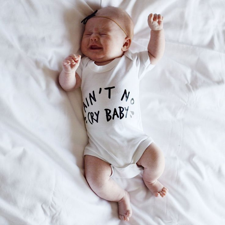 Ain't No Cry Baby Bodysuit | This fun and funky 'Ain't No Cry Baby' bodysuit is perfect for your little babes. Coming in a range of sizes, from 0 – 24 months, and made in the UK from the most super soft cotton, these practical yet stylish babygrows also come with a 3 popper fastening for quick and easy access. This original baby couture bodysuit has our own hand printed unique design on the front, Whether worn on its own or under the clothes to keep baby extra snug, this funky babygrow will…