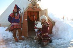 Sami people with a reindeer and one of their portable houses. Robyn's mother read that Sami people were nomadic and followed their herds of reindeer. (Snowy Wishes, p. 78)