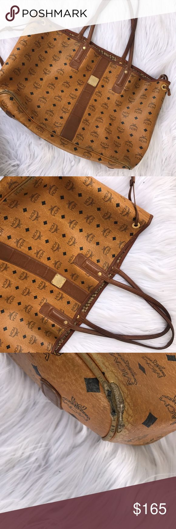 MCM LEATHER GIANT REVERSIBLE TOTE BAG PURSE Giant MCM bag that has had some good wear as shown :) reason for price but nonetheless 100% authentic MCM BAG MCM Bags