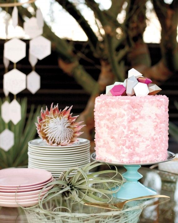 Paper gems topped a hexagon-shaped chocolate cake frosted in vanilla buttercream and covered in crushed rock candy.