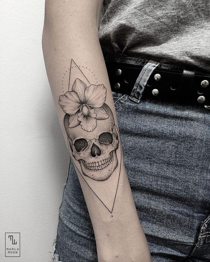 Dotted skull tattoo