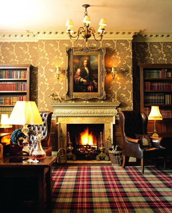 Traditional ~ Portrait painting, plaid carpet, leather wing chair, bookcases, patterned wallpaper