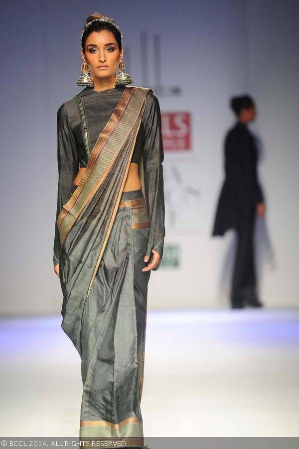 Former Miss India Kanishtha Dhankar walks the ramp for designer Arjun Saluja on Day 3 of Wills Lifestyle India Fashion Week (WIFW) autumn-winter (AW) 2014, held in Delhi, on March 28, 2014.