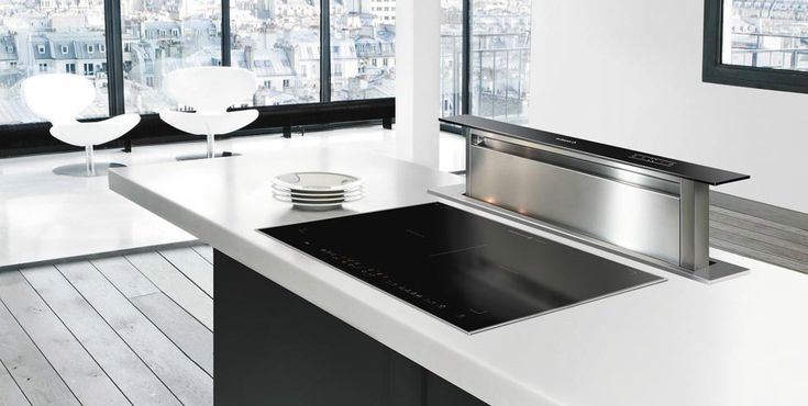 De Dietrich, a relatively unknown brand in Australia, make a unique extractor that is built into the kitchen bench next to the cooktop - instead of the typical range hood above the cooktop. The unit neatly raises up for cooking, and lowers down to bench height to be out of sight. Great for kitchen islands. #DeDietrich #Rangehoods