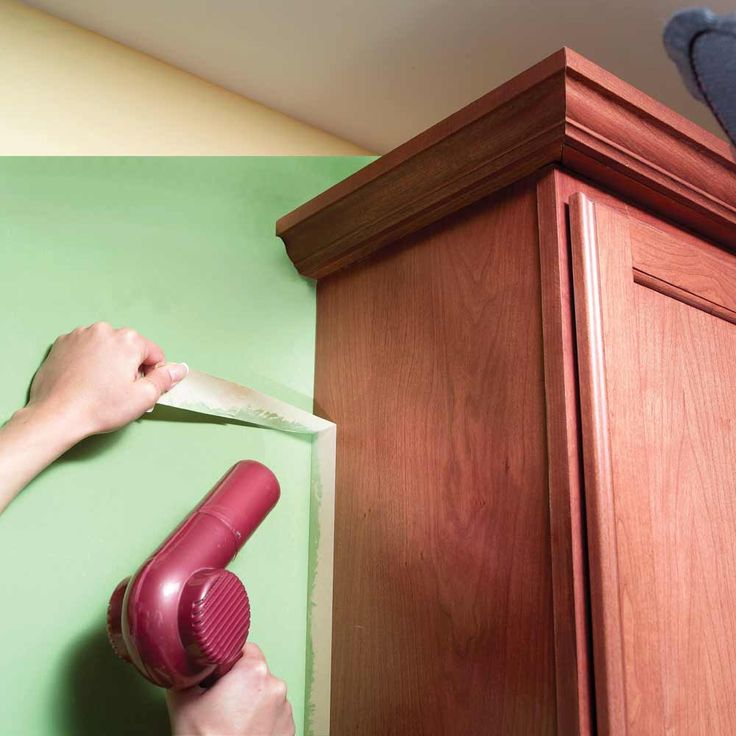 Release Masking Tape with Heat  If masking tape tears as you remove it or pulls off flakes of finish, heat it with a hair dryer. Heat softens the adhesive. Then pull the tape off at a 90-degree angle.