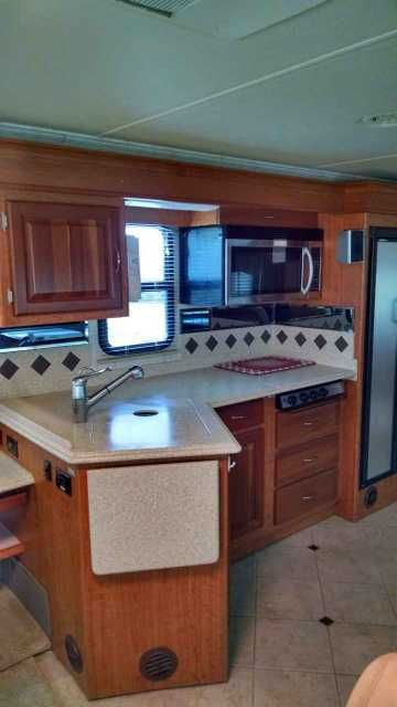 2006 Used National Tropical LX T350 Class A in Pennsylvania PA.Recreational Vehicle, rv, 2006 National Tropical LX T350, Great RV in great shape, but must sell. Freightliner Chassis; Allison Transmission; DuPont Corian counter tops; cherry wood cabinets; washer/dryer combination; 2 flat screen TVs; queen size bed; DVD/VCR/CD players; GPS; satellite dish; ceramic tile floors; cedar lining in wardrobe; microwave/ convection oven combination. $77,000.00