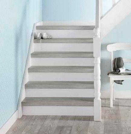 Grijs laminaat op uw trap. Bebo Parket bekleedt uw trap in het gewenste materiaal!