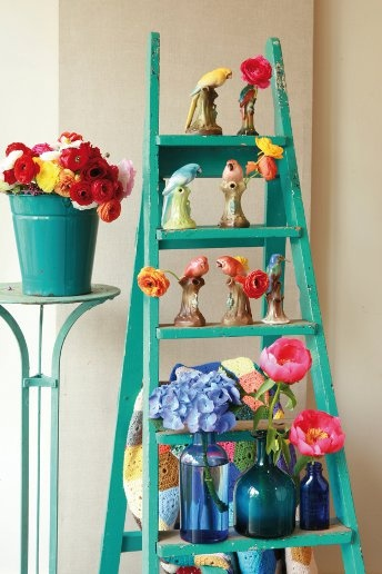 For an eye-catching display, swap plain old vases for more unusual, brightly-coloured containers.