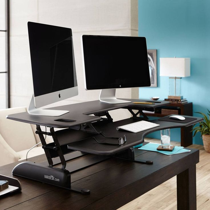 the varidesk pro plus 48 is a standing desk designed with a spacious
