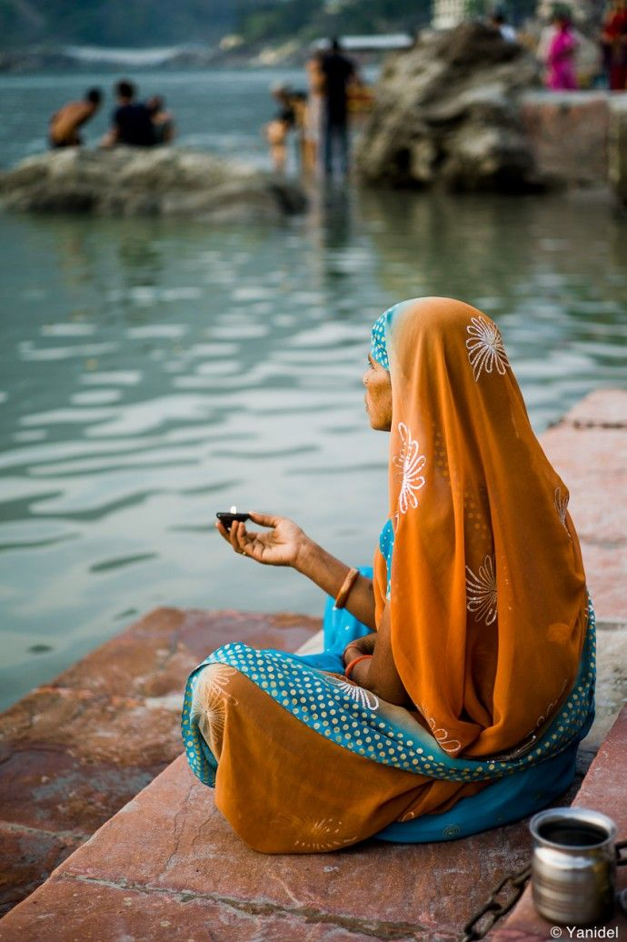 Rishikesh devotee on the banks of Ganges