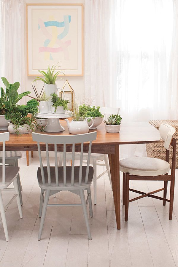 Between big meals and parties, dining room tables still need some love—look how easily this lovely version with basic white dishes from Target and plants comes together. Brilliant.