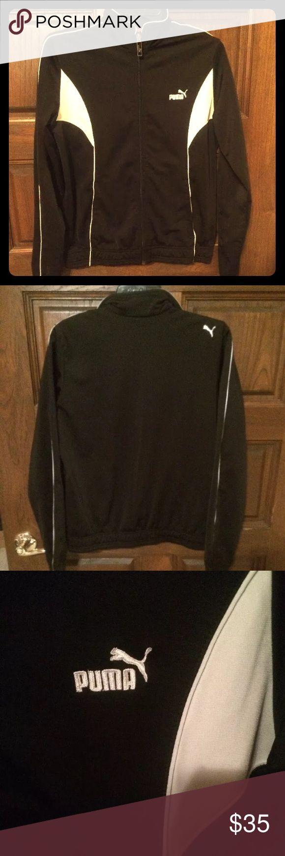 Black and White Puma Zip Up Track Style Jacket Like new black puma zip up track jacket. In excellent condition. Only worn a couple times. No stains, rips or holes. Women's large.  From a pet free and smoke free home. Puma Jackets & Coats Blazers