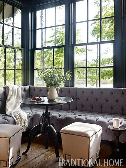 An ac modating low back tufted gray banquette offers