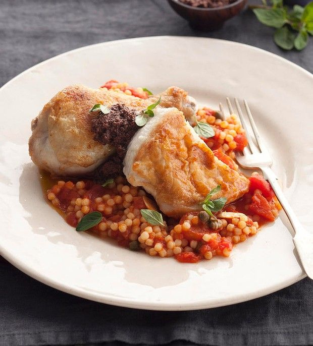 Pan fried chicken with fregola.
