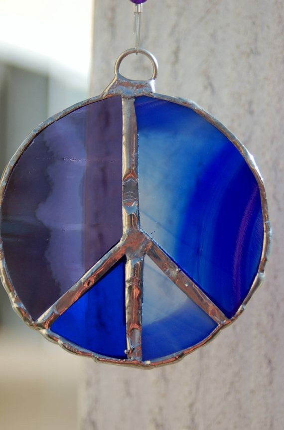 purple and blue peace sign stained glass sun by
