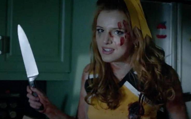 Bella Thorne kisses co-star Samara Weaving and dresses as a sexy cheerleader in trailer for new Netflix movie The Babysitter