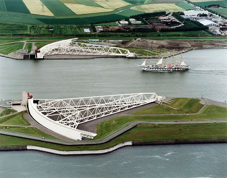 "The Maeslantkering is a storm surge barrier on the waterway at ""Hoek van Holland"" which is the entrance of the port of Rotterdam."