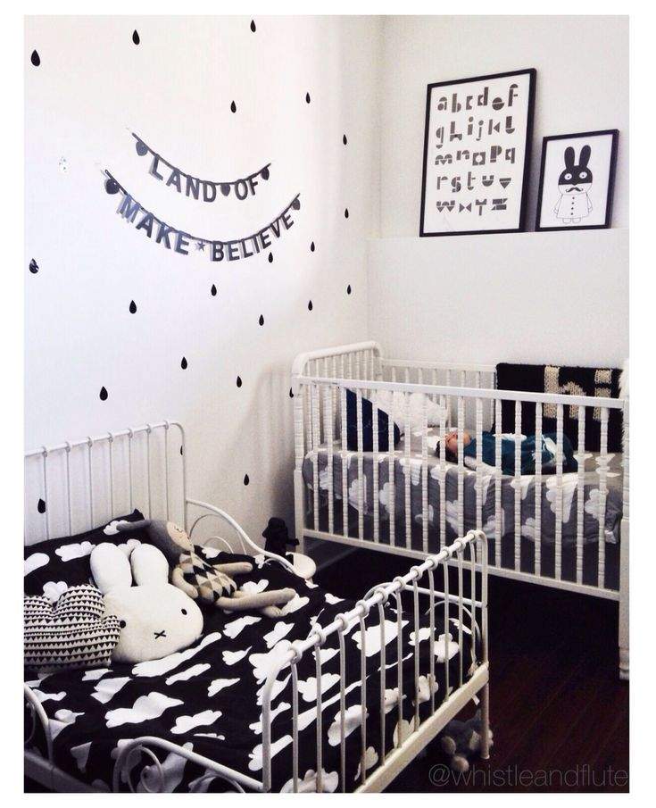 Monochrome modern shared toddler and baby room. Source details on ig: @Whistle Dog Flute Clothing