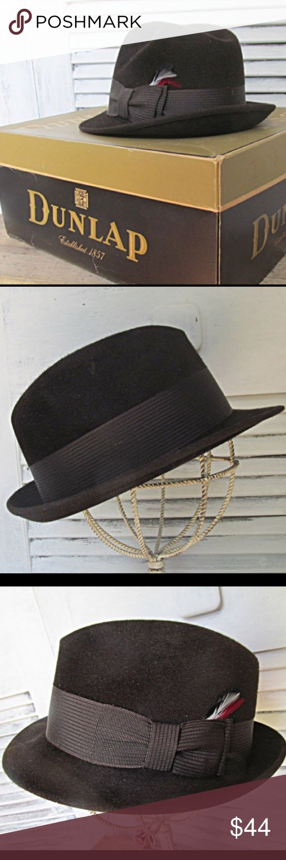 "Vintage Dunlap Fedora Brown  Hat in Original Box Pristine Dark Brown fedora has a red and white feather detail. This hat is adorned with a wide ribbon. Circumference measures 22""  Inner markings read: Dunlap Supreme New York Publix Store For Men Royal Oak Size 6 7/8 Silk Finish  Fedora Brown Mens Vintage Hat Size 7 Rare Collectible Old Stetson  Photos offer the best description. Thanks for looking Dunlop Accessories Hats"