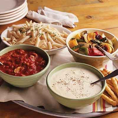 Easy entertaining with a pasta bar: Choose from fresh roasted vegetables, a hearty Italian sausage meat sauce. or a two-cheese Alfredo sauce to top your plate of pasta.