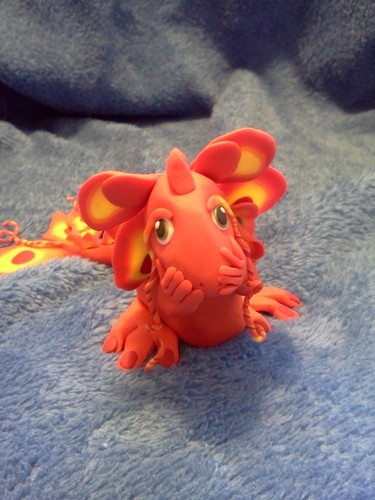 This is one of my absolute favorite dragons.  The colors are amazing and the story is adorable!
