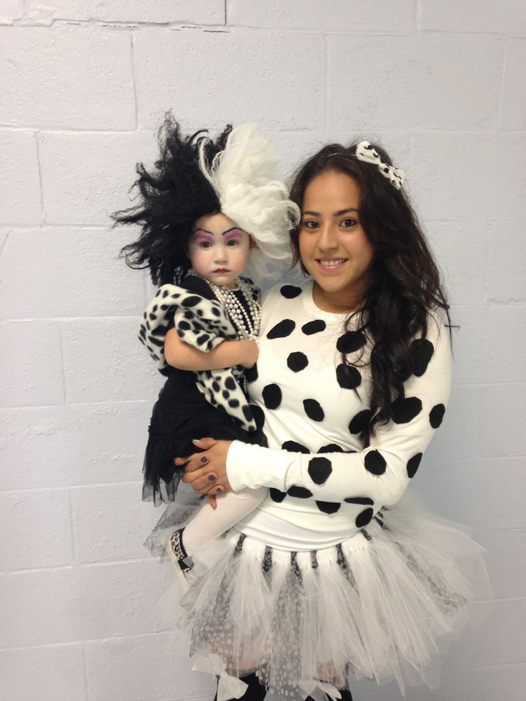 Matching Halloween costumes for daughter and mother. Cruella Deville and a Dalmatian :)