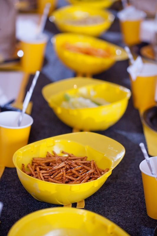 Construction hats as bowls. LOVE this idea for a construction themed party.
