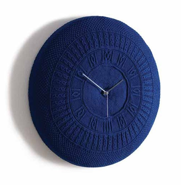 The Gomitolo wall clock is the result of a collaboration between an industrial designer and a fashion designer. Covered in a removable and washable knitted cover in various colours. Time has never been so cosy. Available in Off White, Blue and Red. Made in Italy by designers and clock makers Diamantini & Domeniconi.    Medium: 50cm Diameter x 10cm Deep  Large: 90cm Diameter x 12cm Deep