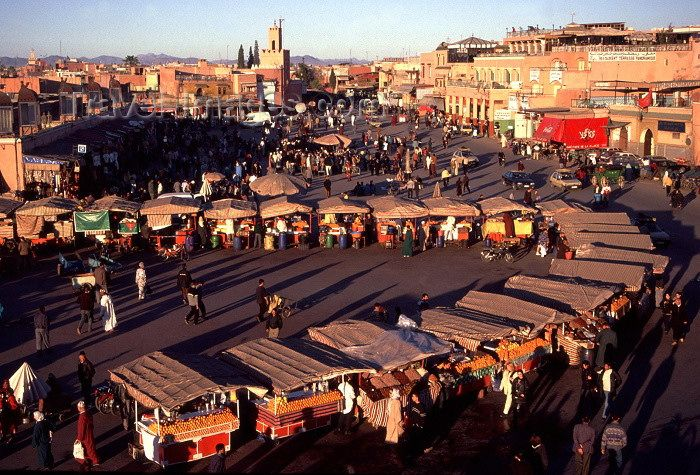 Visit the Djemaa el Fna (Market square) in Marrakech, Morocco at sundown, when it wakes up and becomes an entertainment paradise. I want to grab a bite to eat and take it all in!