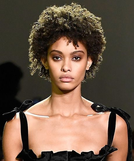 Natural hair on the runway: Pretty bow straps and lustrous curls made for a stunning evening look at Brock.