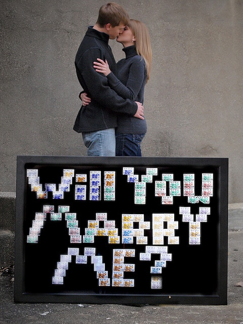 Ryan had kept the ticket stubs from EVERY movie he and Ashley had seen together.  He made this sign with them, and then where the 'dot' is at the bottom of the question mark, he placed the ring box.  How stinkin' romantic and clever is that?  {10.30.09}