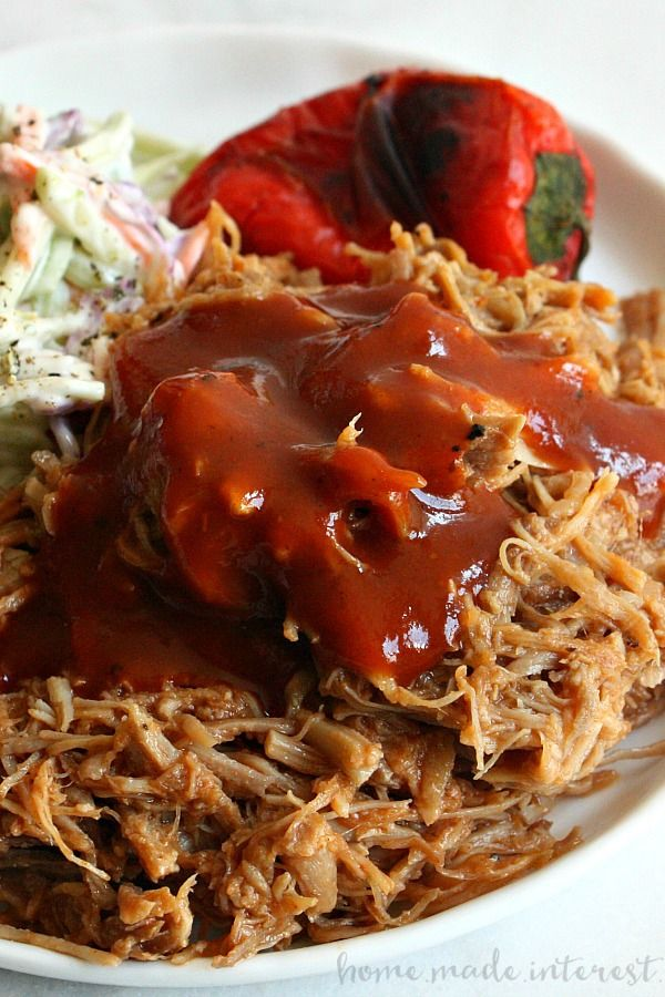 Make BBQ pulled pork in less than time with this easy Pressure Cooker Pulled Pork recipe. If you have an Insta-pot or any pressure cooker this pulled pork recipe is for you! Just put the pork and sauce in the pressure cooker, set and forget. When the timer goes off you have tender BBQ pulled pork that is perfect for sandwiches and sliders!