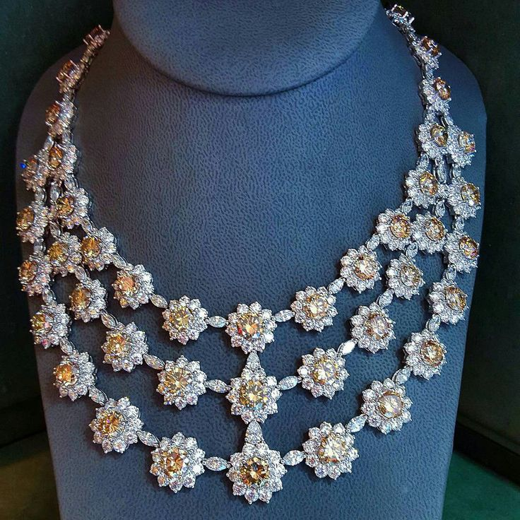 The all-classic and festive triple tiered Natural color COGNAC round brilliant cut and colorless Diamond Bib Necklace, 133.33 carats combined weight, mounted on 18K white gold. BLING ON YOUR HOLIDAYS in SHARP JEWELS!