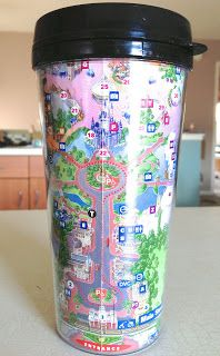 A DIY Disney Travel Mug - so easy.  And a great use for those colorful Disney Park Maps!